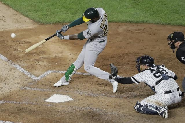 Oakland Athletics' Jurickson Profar follows through on a two-run double during the sixth inning of the team's baseball game against the New York Yankees on Friday, Aug. 30, 2019, in New York. (AP Photo/Frank Franklin II)