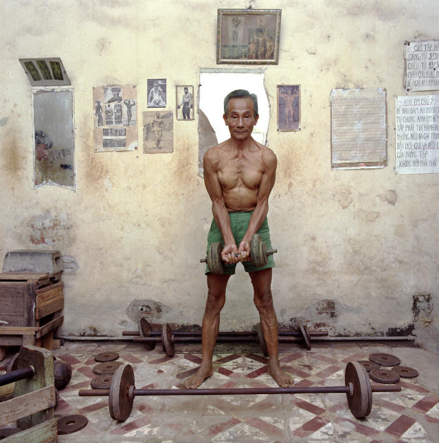 "<p>Weightlifter, 1987. (© William E. Crawford from the book ""Hanoi Streets 1985-2015: In the Years of Forgetting"") </p>"