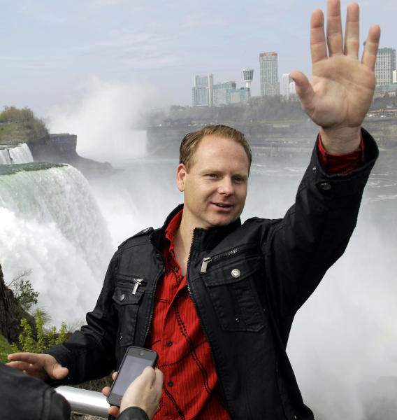 Nik Wallenda waves to tourists after a news conference in Niagara Falls, N.Y., Wednesday, May 2, 2012. Wallenda will try to cross the Niagara Gorge on a tightrope June 15. The seventh-generation member of the Flying Wallendas spent months getting the necessary permissions from Canada and the United States for the cross-border stunt. (AP Photo/David Duprey)