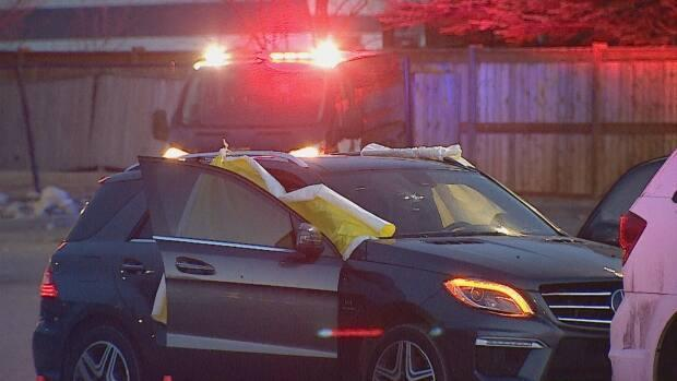 In 2019, two men were fatally shot in this car on 37th Avenue N.E. On Wednesday, three people were charged with first-degree murder.  (Mike Symington/CBC - image credit)