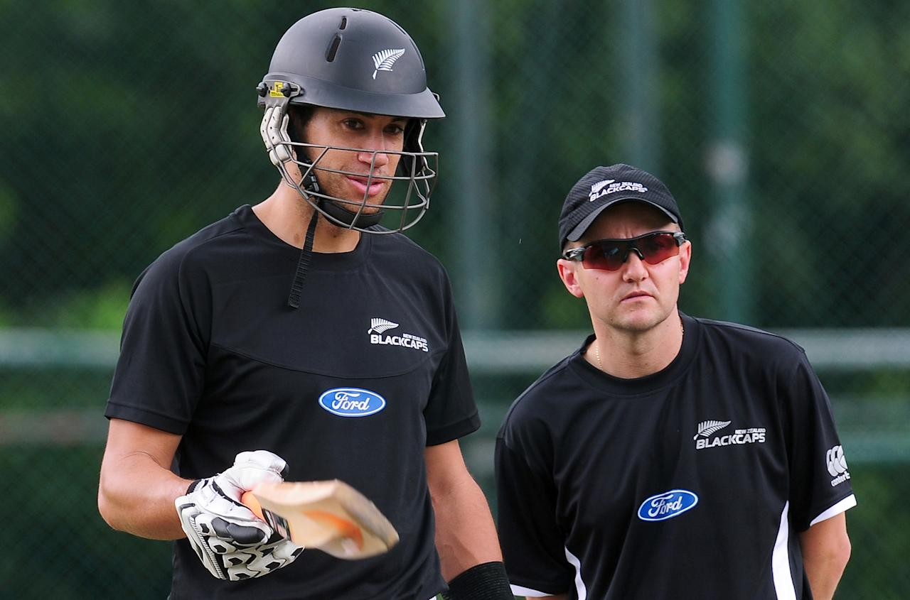 New Zealand cricket captain Ross Taylor (L) and coach Mike Hesson watch during a training session at the Pallekele International Cricket Stadium in Pallekele on October 31, 2012.   AFP PHOTO/ LAKRUWAN WANNIARACHCHI        (Photo credit should read LAKRUWAN WANNIARACHCHI/AFP/Getty Images)