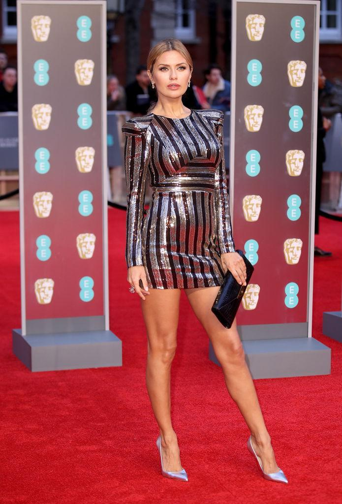 <p>Television presenter Victoria Bonya opted for a metallic dress and co-ordinating heels for the BAFTA red carpet. <em>[Photo: Getty]</em> </p>