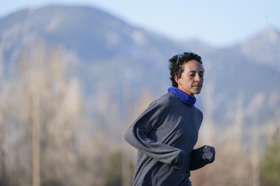 Runner Maggie Montoya is shown as she trains with fellow runners at a park on the east side of Boulder, Colo., Friday, April 9, 2021. The Olympic hopeful was working in the pharmacy at the King Soopers supermarket in Colorado on March 22 when 10 people were killed in the mass shooting. The next day, Montoya was picked up by her dad and taken home to Arkansas. It was a chance to be with family and remember those who lost their lives.(AP Photo/David Zalubowski)