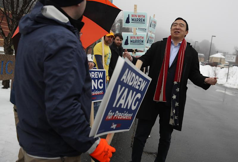 Democratic presidential candidate Andrew Yang greets supporters in who are holding signs in front of a polling station on February 11, 2020 in Keene, New Hampshire. New Hampshire holds its first in the nation primary today. (Photo by Justin Sullivan/Getty Images)