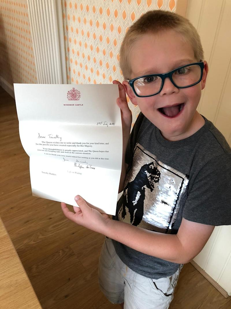 Seven-year-old Timothy Madders of Billericay in Essex with the reply he received from Windsor Castle thanking him for his thoughtfulness after he sent the Queen a word search that he made in case she felt sad or lonely during lockdown.