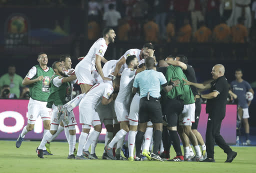 Tunisian players celebrate after a goal during the African Cup of Nations quarterfinal soccer match between Madagascar and Tunisia in Al Salam stadium in Cairo, Egypt, Thursday, July 11, 2019. (AP Photo/Hassan Ammar)