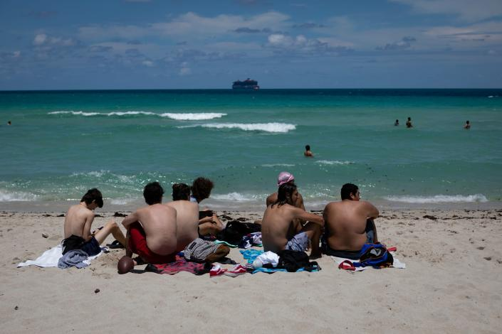 Beachgoers sunbathe in Miami Beach, Florida on June 16, 2020. (Eva Marie Uzcategui/AFP via Getty Images)