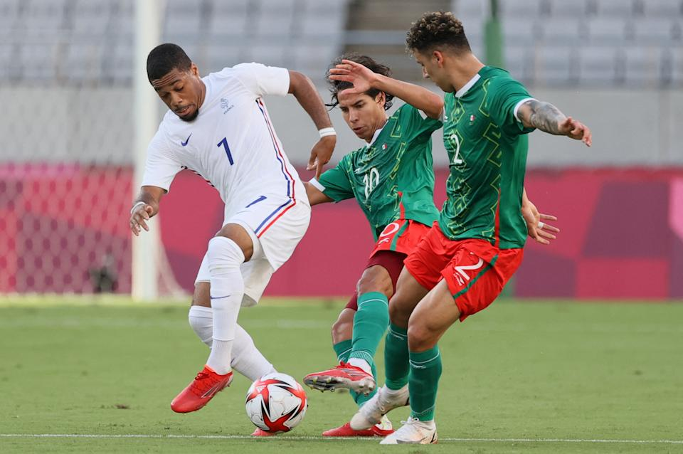 France's forward Arnaud Nordin (L) is marked by Mexico's forward Diego Lainez (C) and Mexico's defender Jorge Sanchez during the Tokyo 2020 Olympic Games men's group A first round football match between Mexico and France at Tokyo Stadium in Tokyo on July 22, 2021. (Photo by Mariko Ishizuka / AFP) (Photo by MARIKO ISHIZUKA/AFP via Getty Images)