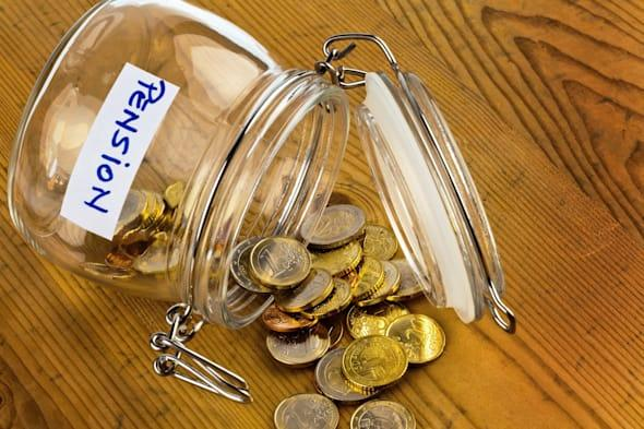 gold coins in a jam jar. the...