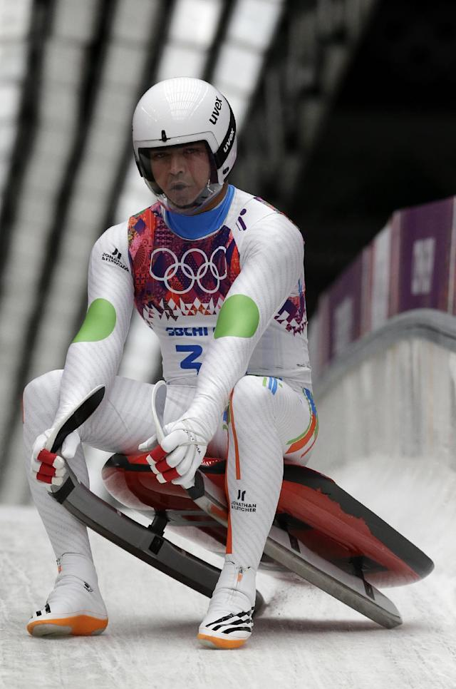 Shiva Keshavan, who if from India but is competing under the Olympics flag, brakes in the finish area during the men's singles luge final at the 2014 Winter Olympics, Sunday, Feb. 9, 2014, in Krasnaya Polyana, Russia. (AP Photo/Michael Sohn)