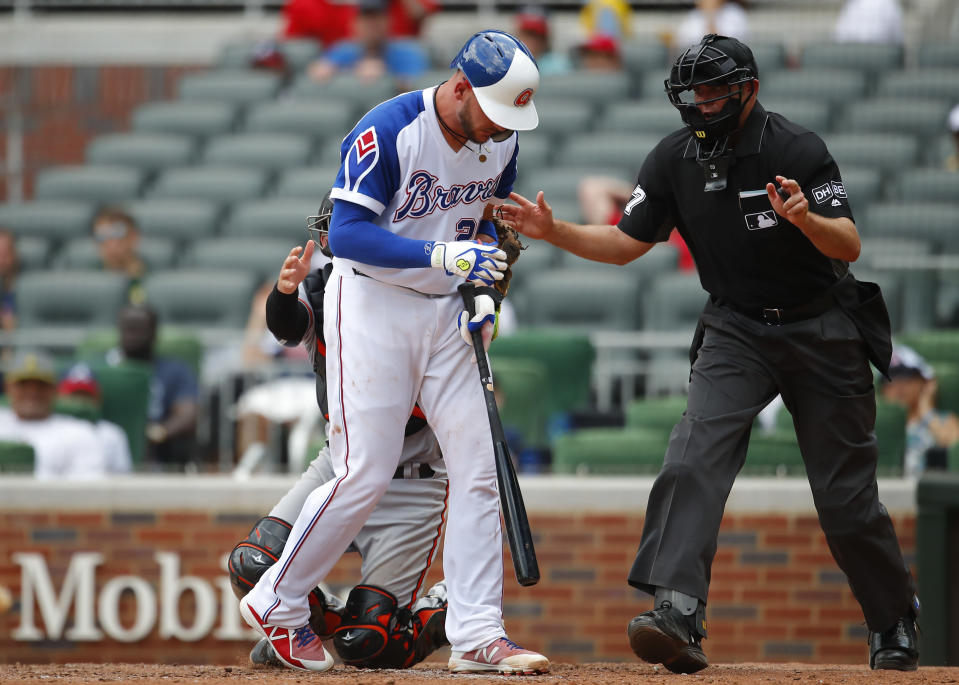 Atlanta Braves' Tyler Flowers (25) reacts after being hit by a pitch in the fifth inning of a baseball game against the Baltimore Orioles, Sunday, June 24, 2018, in Atlanta. (AP Photo/Todd Kirkland)