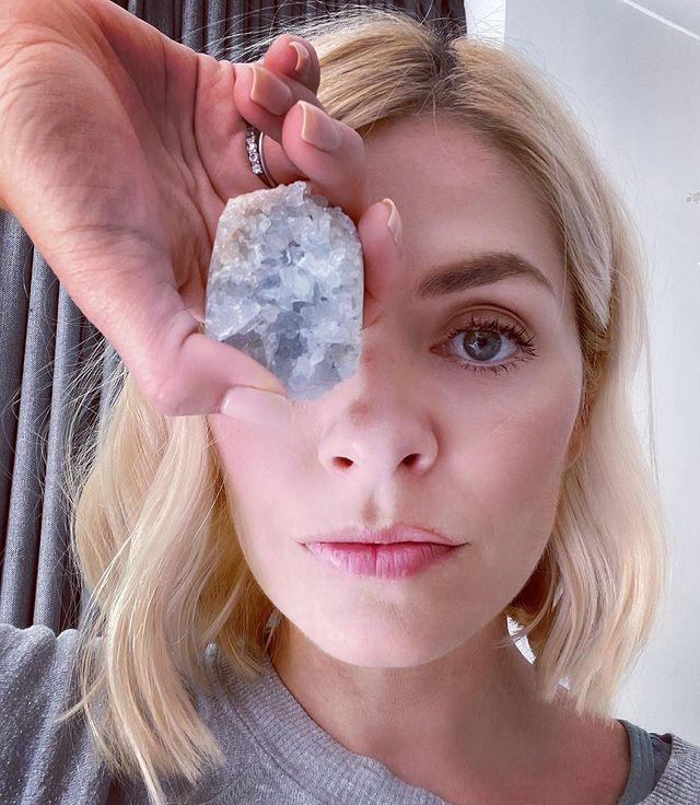 """<p>Much like burning sage, using healing crystals – which are believed, by some, to contain properties such as providing strength and nurturing love – are often used in more alternative health circles. </p><p>Holly has shared multiple snaps of her collection and has spoken about using different stones to purify her home and to give her energy. She has even stated that she used a piece of green fluorite, thought to offer soothing vibes, to help her 6-year-old son, Chester's, nightmares, laying it by his bed. She's such a fan of crystals that her co-host, Phillip Schofield, <a href=""""https://www.mirror.co.uk/3am/celebrity-news/philip-schofield-blames-holly-willoughby-23991035"""" rel=""""nofollow noopener"""" target=""""_blank"""" data-ylk=""""slk:has said"""" class=""""link rapid-noclick-resp"""">has said</a> that he has started to use them, after Holly sang their praises. </p><p>If you want to bring crystals into your life, <a href=""""https://podcasts.apple.com/gb/podcast/victoria-beckham-louise-redknapps-crystal-healer-on/id1492260707?i=1000493181548"""" rel=""""nofollow noopener"""" target=""""_blank"""" data-ylk=""""slk:listen to this episode"""" class=""""link rapid-noclick-resp"""">listen to this episode </a>of the WH podcast, Going For Goal, which fills you in on what you need to know. </p><p><a href=""""https://www.instagram.com/p/CP0qO_SBtCj/"""" rel=""""nofollow noopener"""" target=""""_blank"""" data-ylk=""""slk:See the original post on Instagram"""" class=""""link rapid-noclick-resp"""">See the original post on Instagram</a></p>"""
