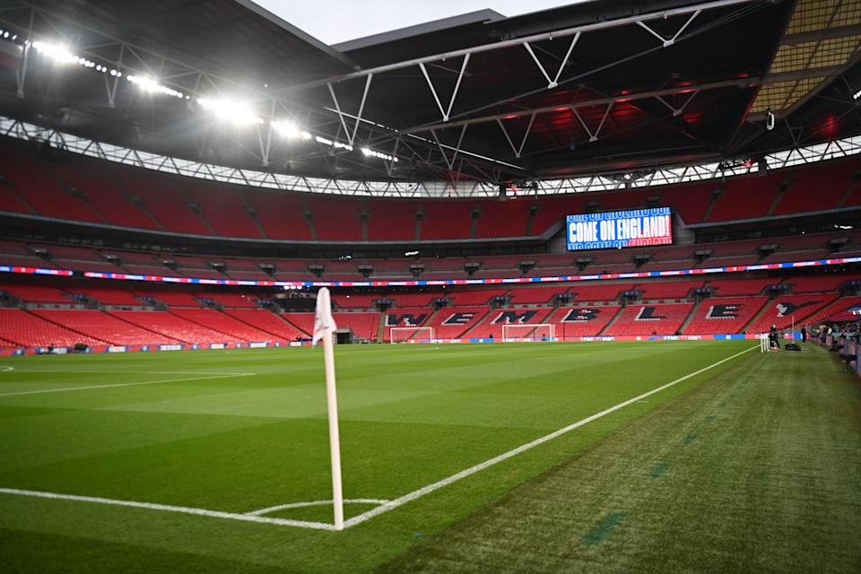 A picture shows the empty interior of Wembley Stadium in London on March 31, 2021 ahead of the FIFA World Cup Qatar 2022 Group I qualification football match between England and Poland. - - NOT FOR MARKETING OR ADVERTISING USE / RESTRICTED TO EDITORIAL USE (Photo by Andy Rain / various sources / AFP) / NOT FOR MARKETING OR ADVERTISING USE / RESTRICTED TO EDITORIAL USE (Photo by ANDY RAIN/AFP via Getty Images) (Photo: ANDY RAIN via AFP via Getty Images)