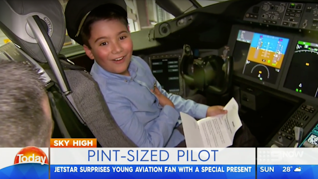 Francis's face said it all when he was told he was going to fly business. (Photo: Channel 9 Melbourne)
