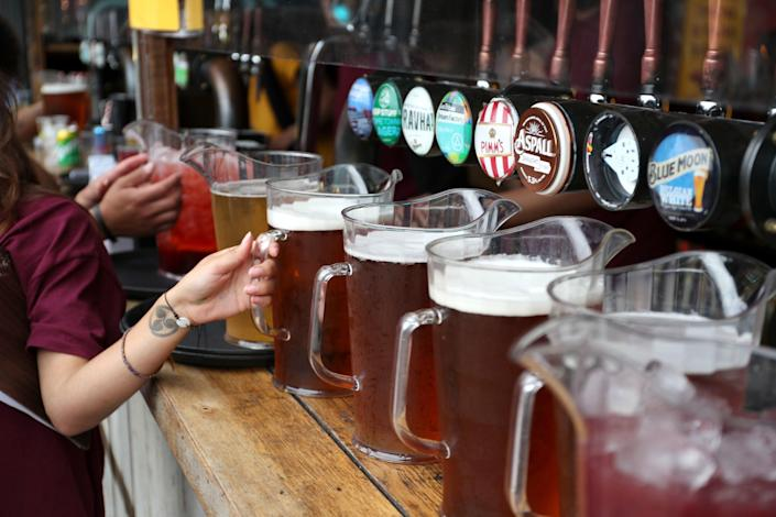Drivers responsible for 40 per cent of UK beer deliveries could strike amid a pay dispute (PA)