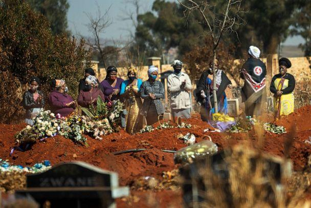 PHOTO: Mourners pray during a burial ceremony at the Olifantsveil Cemetery outside Johannesburg, South Africa, on Aug. 6, 2020. (Jerome Delay/AP)