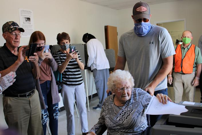 Centenarian Mabel Dorothy Duty Cook of Chesterfield casts her ballot at the Registrar's Office in Chesterfield on Oct. 15, 2020. Family members from left to right capture the moment, Sherman, Alexa, Linda, and Curtis Litton.