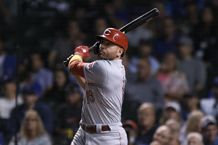 Cincinnati Reds' Joey Votto watches his solo home run during the fourth inning of the team's baseball game against the Chicago Cubs on Wednesday, Sept. 8, 2021, in Chicago. (AP Photo/Paul Beaty)