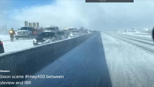 This still image is taken from a Twitter video shot by Sgt. Kerry Schmidt, spokesperson for the Ontario Provincial Police's highway safety division. He shot it from his vehicle on Highway 400's northbound lanes when it was closed from Highway 89 to Mapleview Drive. (Ontario Provincial Police - image credit)