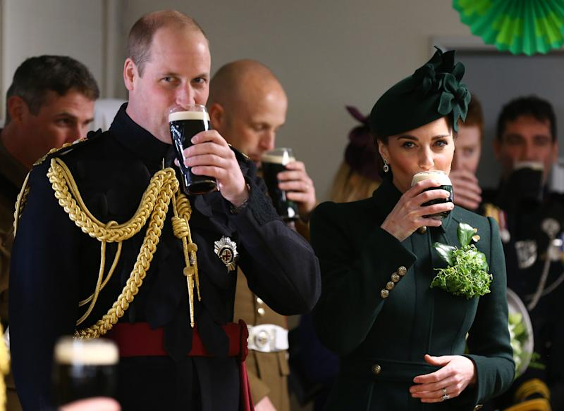 TOPSHOT - Britain's Prince William, Duke of Cambridge and Britain's Catherine, Duchess of Cambridge enjoy a pint of Guinness with officers and guardsmen of the 1st Battalion Irish Guards after the St Patrick's Day parade, at Cavalry Barracks in Hounslow, west London, on March 17, 2019. (Photo by Gareth Fuller / POOL / AFP) (Photo credit should read GARETH FULLER/AFP via Getty Images)