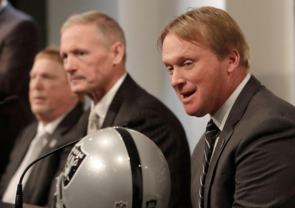 Oakland Raiders head coach Jon Gruden, right, speaks next to Mike Mayock, center, and owner Mark Davis at a news conference announcing Mayock as the general manager at the team's headquarters in Oakland, Calif., Monday, Dec. 31, 2018. (AP Photo/Jeff Chiu)