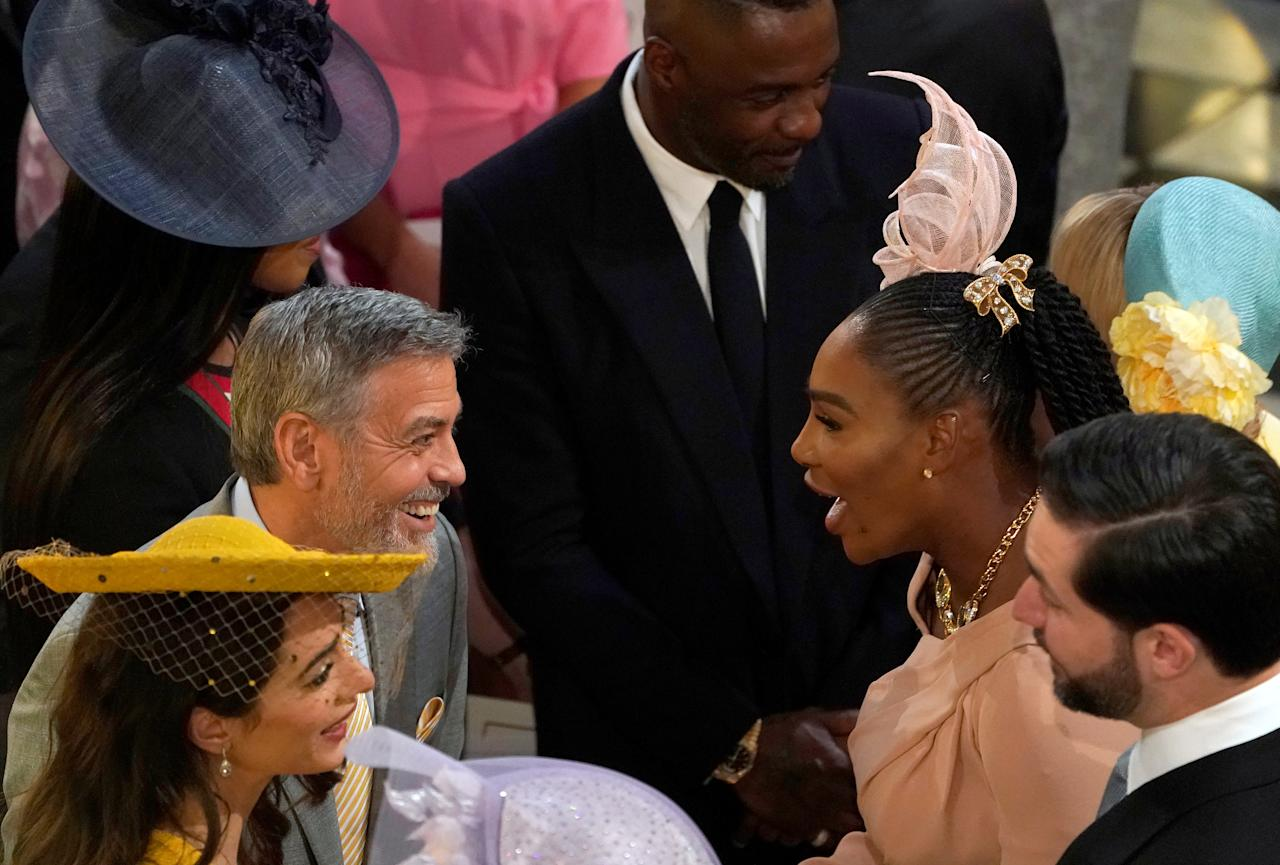 George Clooney greets Serena Williams as in St George's Chapel at Windsor Castle for the wedding of Prince Harry and Meghan Markle Windsor, Britain May 19, 2018. Owen Humphreys/Pool via REUTERS