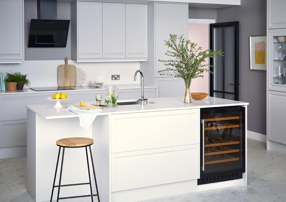 """<p>Keeping your white kitchen clean and streamlined means some clever design features. Opt for sleek, handleless cabinets, an undermount sink, and integrated features such as this understated wine fridge. </p><p>Pictured: <a href=""""https://www.housebeautiful.com/uk/house-beautiful-collections/a35137588/homebase-kitchen-storage-house-beautiful/"""" rel=""""nofollow noopener"""" target=""""_blank"""" data-ylk=""""slk:House Beautiful Westbourne Kitchen at Homebase"""" class=""""link rapid-noclick-resp"""">House Beautiful Westbourne Kitchen at Homebase</a></p>"""