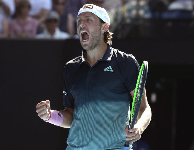 France's Lucas Pouille celebrates after winning a point against Canada's Milos Raonic during their quarterfinal match at the Australian Open tennis championships in Melbourne, Australia, Wednesday, Jan. 23, 2019. (AP Photo/Aaron Favila)