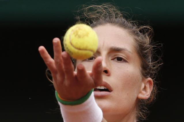Germany's Andrea Petkovic serves the ball during the quarterfinal match of the French Open tennis tournament against Italy's Sara Errani at the Roland Garros stadium, in Paris, France, Wednesday, June 4, 2014. (AP Photo/Darko Vojinovic)