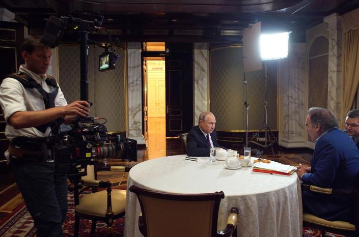 This photo taken on Wednesday, June 19, 2019, and distributed by Kremlin Press Service shows Russian President Vladimir Putin, center, during an interview with American movie director Oliver Stone, right, for his Revealing Ukraine documentary in the Kremlin in Moscow, Russia. (Alexei Druzhinin, Sputnik, Kremlin Pool Photo via AP)