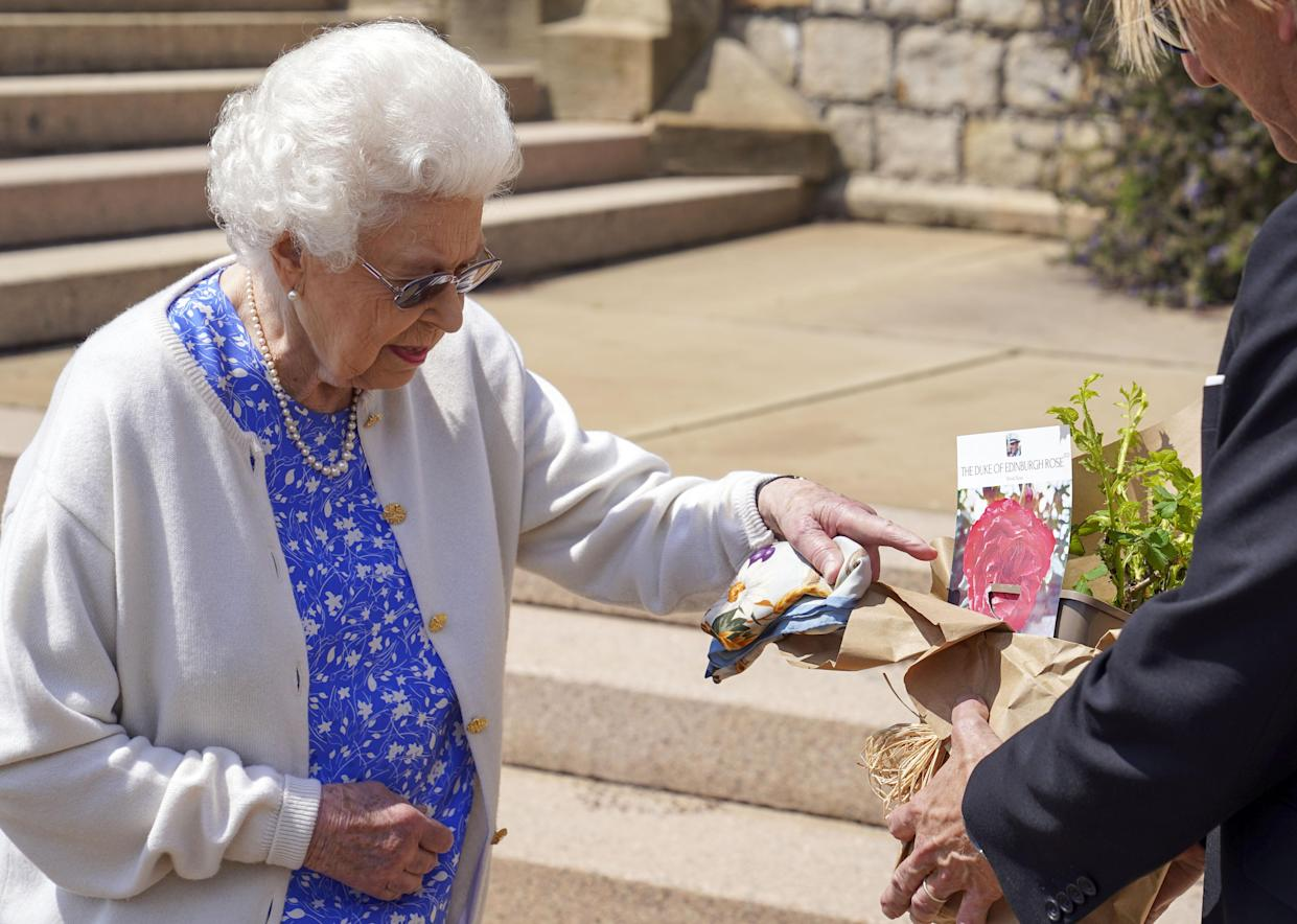 EMBARGOED TO 2200 WEDNESDAY JUNE 9 Queen Elizabeth II receives a Duke of Edinburgh rose, given to her by Keith Weed, President of the Royal Horticultural Society,, at Windsor Castle, Berkshire. The newly bred deep pink commemorative rose from Harkness Roses has officially been named in memory of the Duke of Edinburgh. A royalty from the sale of each rose will go to The Duke of Edinburgh's Award Living Legacy Fund which will give more young people the opportunity to take part in the Duke of Edinburgh Award. Picture date: Wednesday June 2, 2021. The Duke, who died in April this year, would have celebrated his 100th birthday on June 10th.