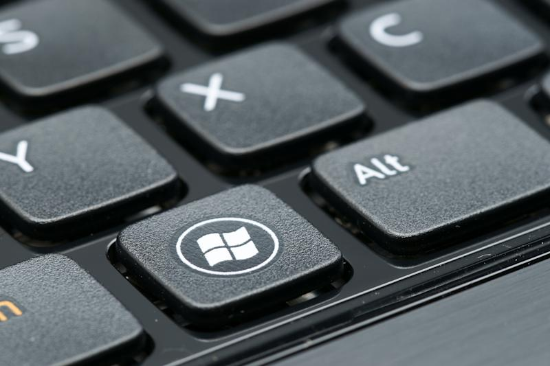 """Celje, Slovenia - October 4, 2012: Windows logo on laptop keyboard button. Windows is a best known product of Microsoft Corporation. Operating systems Windows is installed on 90Aaa of all personal computers in the world"""