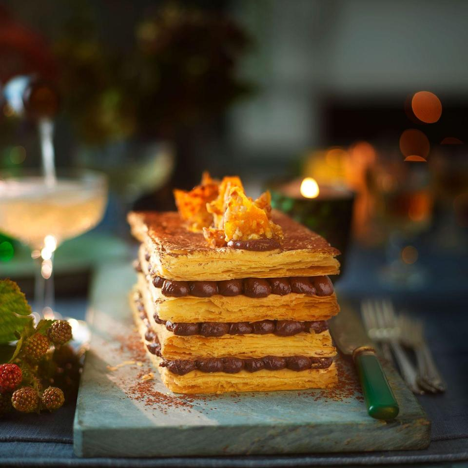 """<p>This showstopper is much easier to make than it looks, and tastes every bit as good.</p><p><strong>Recipe: <a href=""""https://www.goodhousekeeping.com/uk/food/recipes/a29422199/chocolate-hazelnut-millefeuille/"""" rel=""""nofollow noopener"""" target=""""_blank"""" data-ylk=""""slk:Chocolate Hazelnut Millefeuille"""" class=""""link rapid-noclick-resp"""">Chocolate Hazelnut Millefeuille </a></strong></p>"""
