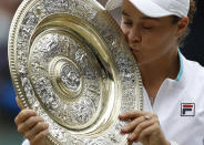 Australia's Ashleigh Barty poses with the winners trophy for the media after winning the women's singles final defeating the Czech Republic's Karolina Pliskova on day twelve of the Wimbledon Tennis Championships in London, Saturday, July 10, 2021. (Pete Nichols/Pool Via AP)