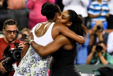 Venus Williams (USA) and Serena Williams (USA) hug after their third round match in the BNP Paribas Open at the Indian Wells Tennis Garden. Venus Williams won the match. Mandatory Credit: Jayne Kamin-Oncea-USA TODAY Sports