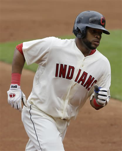 Cleveland Indians' Carlos Santana runs the bases after hitting a two-run home run off Detroit Tigers starting pitcher Doug Fister in the first inning of a baseball game on Sunday, July 7, 2013, in Cleveland. Indians' Michael Brantley also scored. (AP Photo/Tony Dejak)