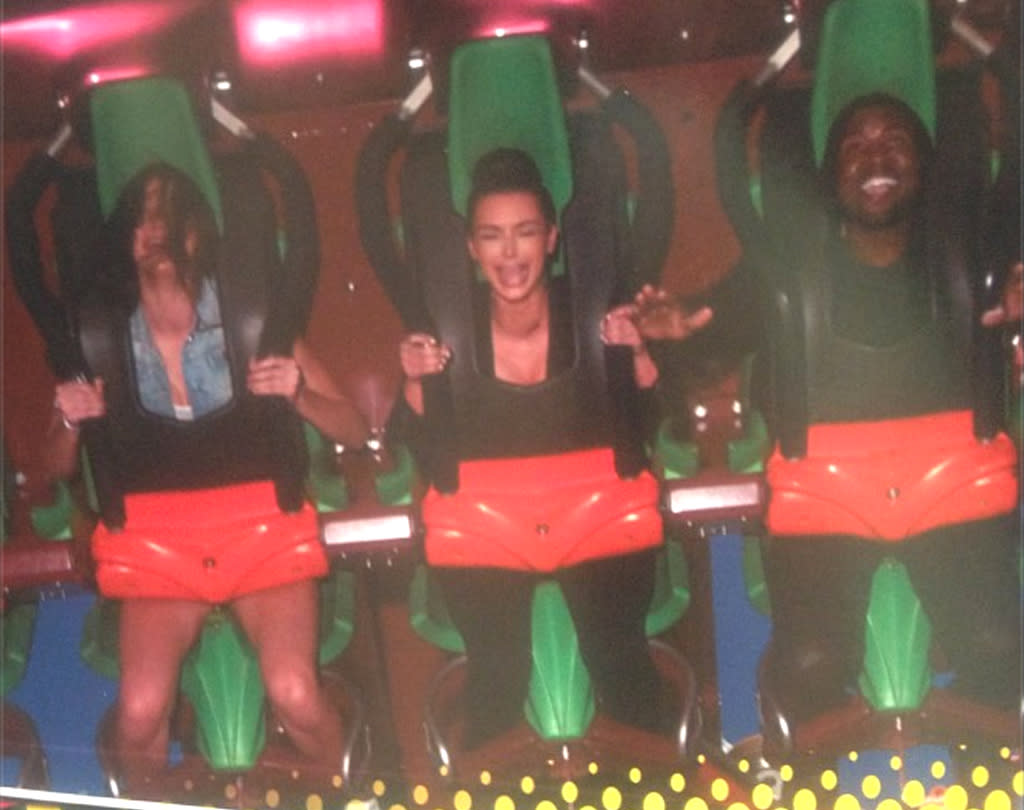 """Kim Kardashian, her boyfriend Kanye West, and her little sister Kendall Jenner clearly had a scream on a ride at Southern California amusement park Six Flags Magic Mountain on Tuesday. """"Another ugly infamous cry face for the records,"""" the reality star wrote when she posted the pic to her Twitter account. Many of us made a similar face recently when we found out """"Keeping Up With the Kardashians"""" had been renewed for three more seasons. (7/17/2012)"""