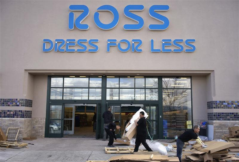 Workers prepare a new Ross store which is opening soon in Broomfield, Colorado