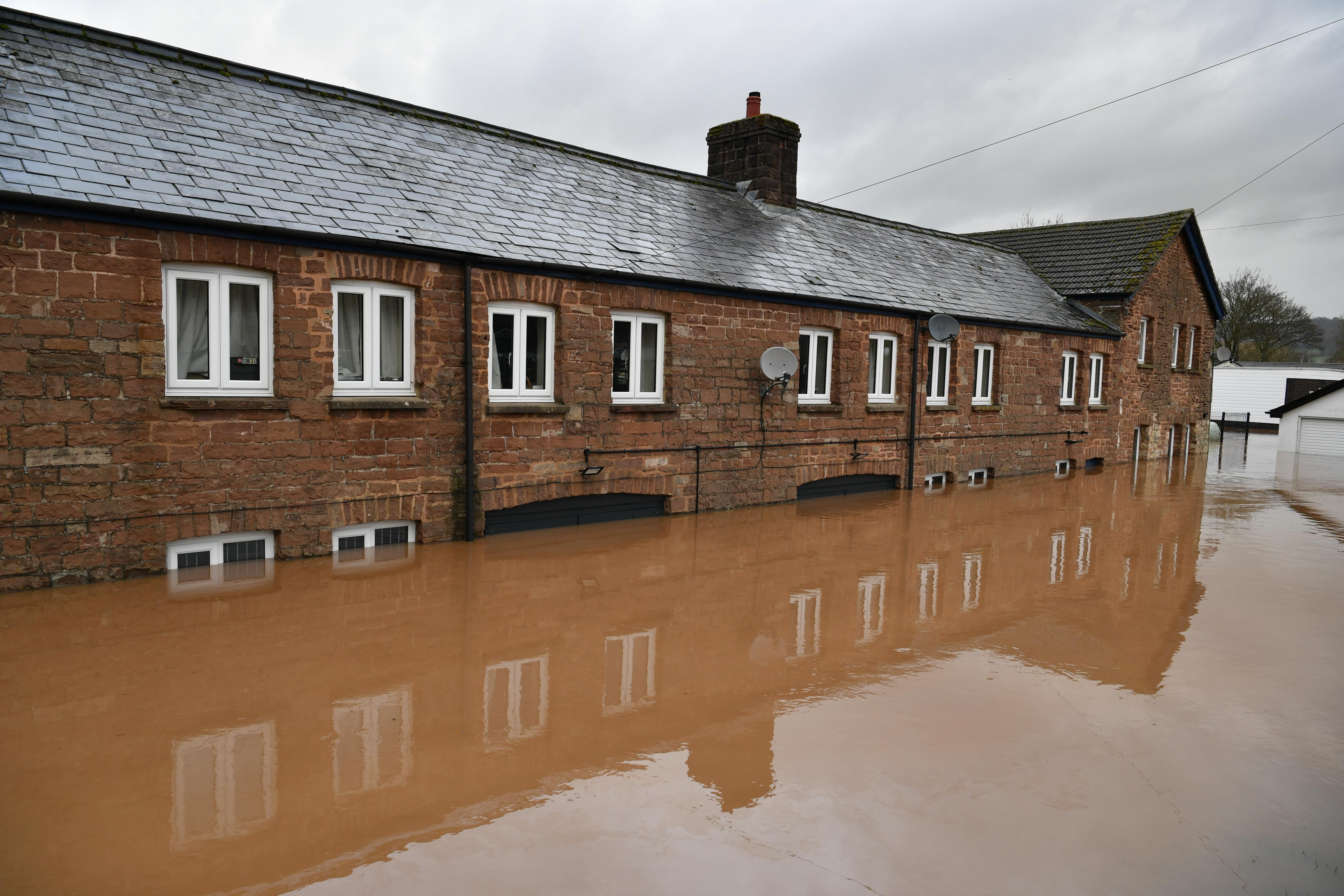 Flooded cottages in Monmouth, in the aftermath of Storm Dennis. (Photo by Ben Birchall/PA Images via Getty Images)