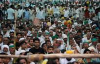 People attend a Maha Panchayat or grand village council meeting as part of a farmers' protest against farm laws in Muzaffarnagar