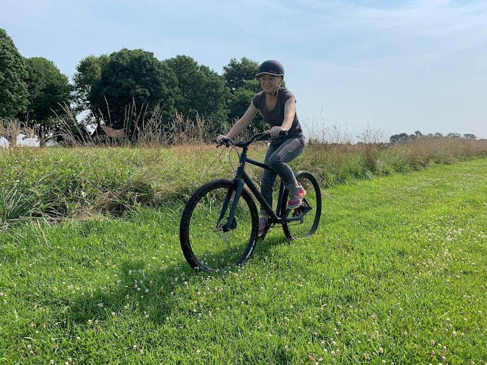Rebecca Garth looks over the rural Kentucky landscape, much of which is ripe for off-road biking. The 30-year-old attorney is one of an estimated 48 million recreational bike riders in the United States. She is riding a Doggler Gravel mountain/hybrid from California startup company Hudski Bikes.