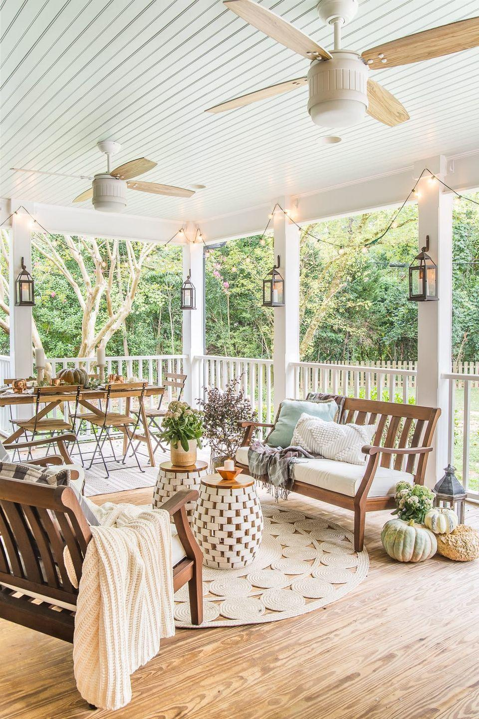 """<p>If you want to make a nod to the season without letting your outdoor pumpkin decorations take over your space, this cozy porch will give you the inspo you need. </p><p><strong>See more at <a href=""""https://www.blesserhouse.com/fall-back-porch-capsule-decor/"""" rel=""""nofollow noopener"""" target=""""_blank"""" data-ylk=""""slk:Bless'er House"""" class=""""link rapid-noclick-resp"""">Bless'er House</a>. </strong></p><p><a class=""""link rapid-noclick-resp"""" href=""""https://www.amazon.com/Barefoot-Dreams-Contrast-Throw-Blanket/dp/B01BLUR2WG?tag=syn-yahoo-20&ascsubtag=%5Bartid%7C2164.g.36877187%5Bsrc%7Cyahoo-us"""" rel=""""nofollow noopener"""" target=""""_blank"""" data-ylk=""""slk:SHOP COZY BLANKETS"""">SHOP COZY BLANKETS</a></p>"""