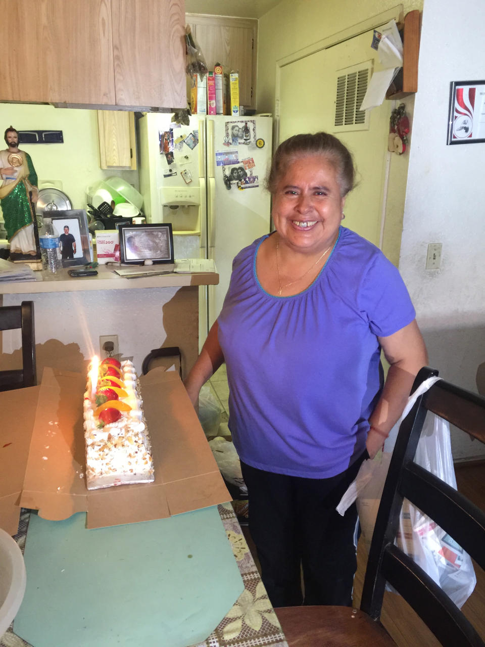FILE - This Aug. 19, 2016 photo provided by Maria Rios Luna shows Bernardina Rios de Luna, 59, who died of COVID-19 in January, in her kitchen in Fontana, Calif. The mother of 7, who was a devout Catholic and loved to cook, is one of tens of thousands of Californians who have died of the virus. Her youngest daughter, Maria Rios Luna, said they don't know how the family was infected but she and her mother and her sister in Fontana, Calif., as well as a niece and nephew who were staying with them, all tested positive for COVID-19. (Maria Rios Luna via AP)