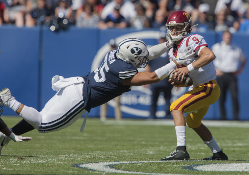 PROVO, UT - SEPTEMBER 14: Lorenzo Fauatea #55 of the BYU Cougars pressures Kedon Slovis #9 of the USC Trojans during their game at LaVell Edwards Stadium on September 14, 2019 in Provo, Utah. (Photo by Chris Gardner/Getty Images)