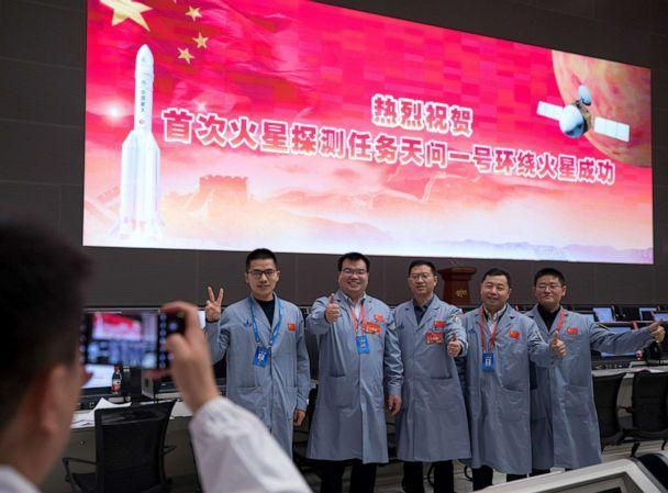 PHOTO: Technical personnel celebrate after China's Tianwen-1 probe successfully entered the orbit around Mars at the Beijing Aerospace Control Center in Beijing, Feb. 10, 2021. (Xinhua/Jin Liwang via Newscom)