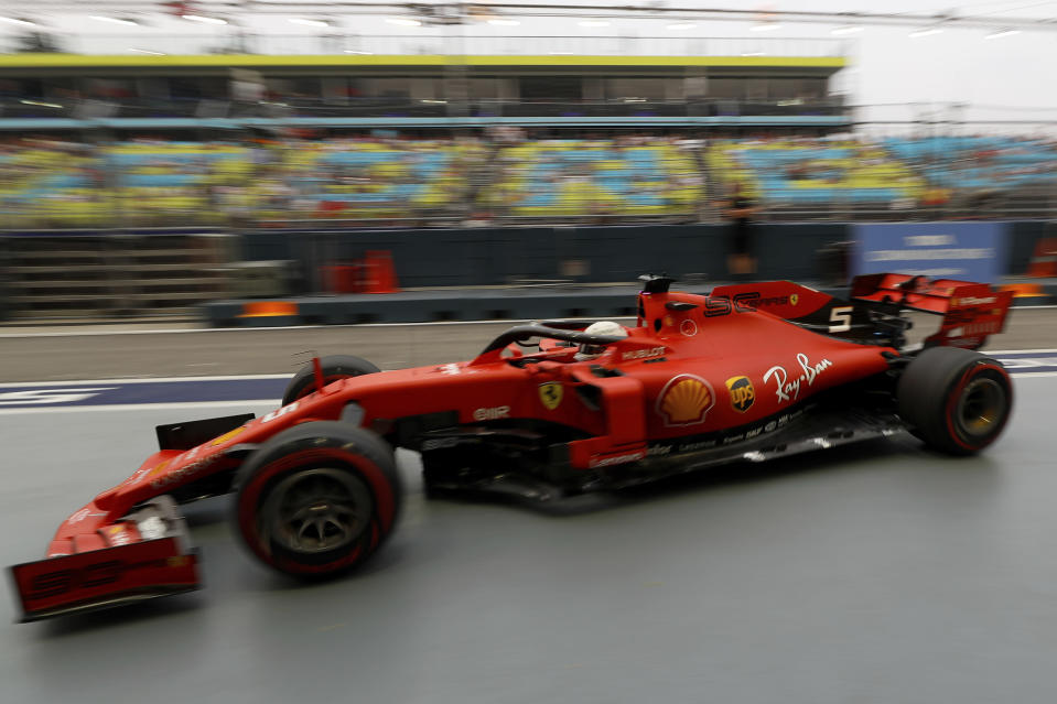 Ferrari driver Sebastian Vettel of Germany steers his car back to his garage during the first practice session at the Marina Bay City Circuit ahead of the Singapore Formula One Grand Prix in Singapore, Friday, Sept. 20, 2019. (AP Photo/Vincent Thian)