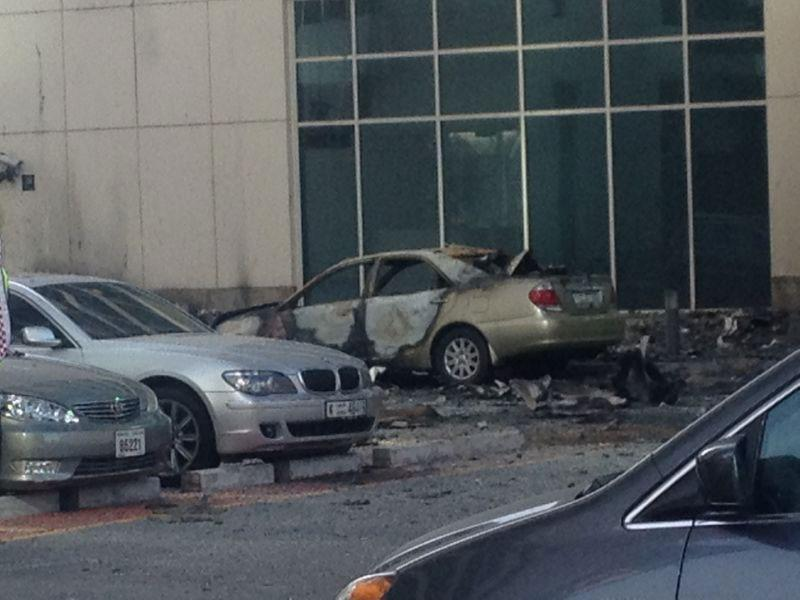 Cars shattered by falling debris.