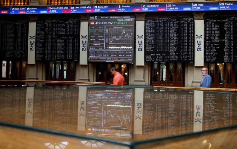 Electronic boards are seen at Madrid stock exchange which plummeted after Britain voted to leave European Union in EU BREXIT referendum, in Madrid