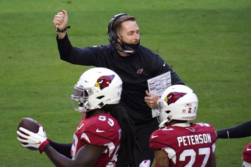 Arizona Cardinals head coach Kliff Kingsbury celebrates a safety during the first half of an NFL football game against the Philadelphia Eagles, Sunday, Dec. 20, 2020, in Glendale, Ariz. (AP Photo/Ross D. Franklin)