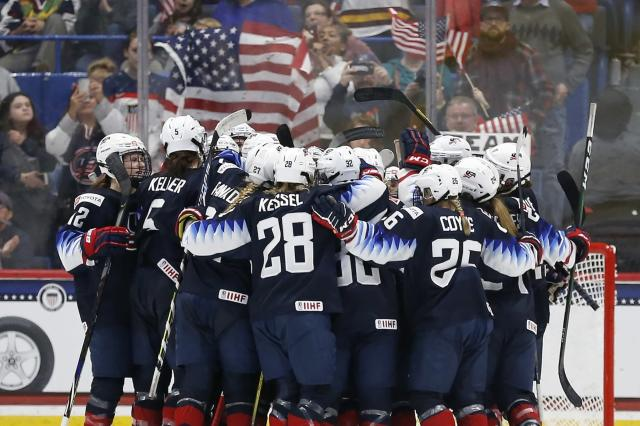 United States players celebrate after defeating Canada during a rivalry series women's hockey game in Hartford, Conn., Saturday, Dec. 14, 2019. (AP Photo/Michael Dwyer)
